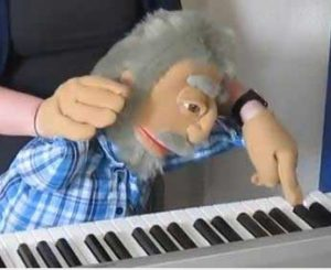 Custom hand puppet man playing piano
