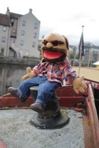 Custom hand puppet man on a boat