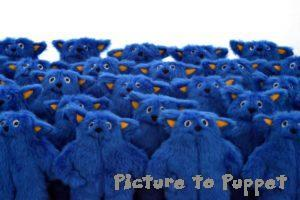 Bulk order of furry blue monster soft toys made to order