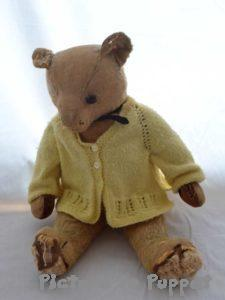teddy bear in need of repairs