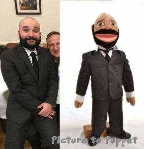 Mini me puppet man in a suit