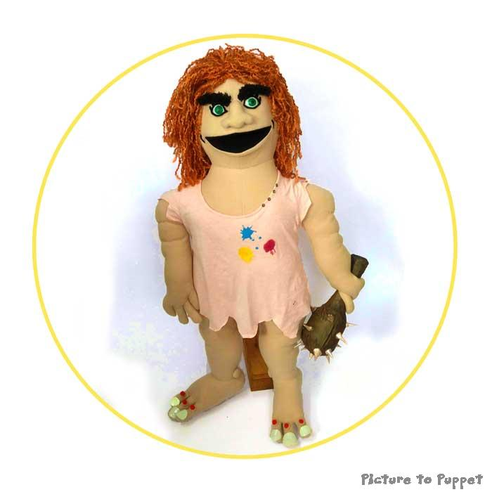 A Custom Hand Puppet Cave Troll with GInger hair and a peach dress with paint on.