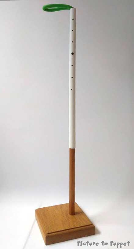Adjustable wooden puppet stand with white upper section with holes in